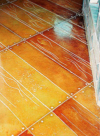 Floor Seasons - For color, he uses Scofield and Kemiko chemical stains almost exclusively. Plastic board is used to prevent bleed, or in some designs one color is put down and sealed before the next is applied. Customers approve colors before the sealer goes down — it's in the contract.
