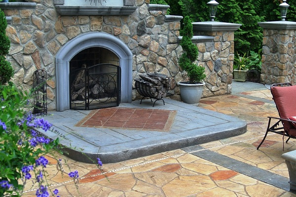 Outdoor concrete fireplace on a back patio
