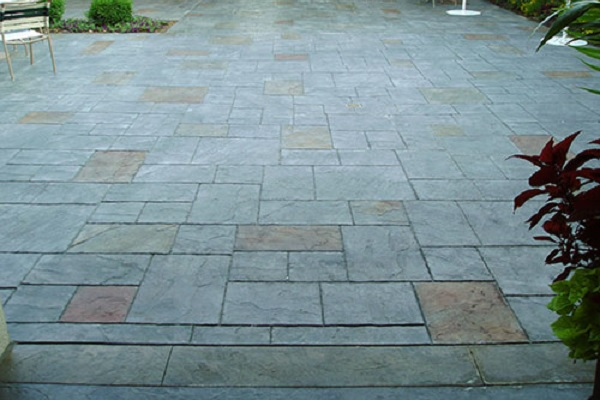 Subtle stamped concrete in multiple neutral colors.