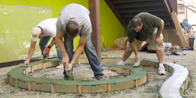 Attendees trowel the formed stems of this large aloe vera courtyard.