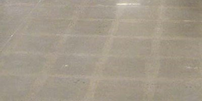 VCT Tile ghosting on polished concrete floor. How to remove ghosting.