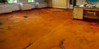 Phoenix company, Flo-Tech Inc., pumped the Floor-Top STG into the room on Wednesday. The next day, Anger and his team applied two treatments of Terracotta Clay acid stain from Cohill's Building Specialties Inc.