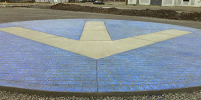 The blue Rocketown logo has been placed in the parking lot of Rocketown with the arrow pointing to the front door.