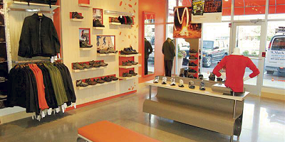 A look at the Puma store with gray concrete overlay on the floor.