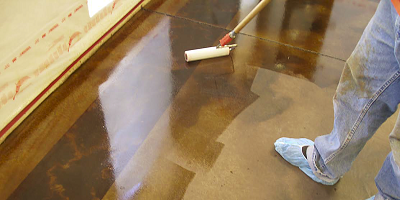 Sealing concrete with a film-form concrete sealer changes the appearance of the colored concrete below.