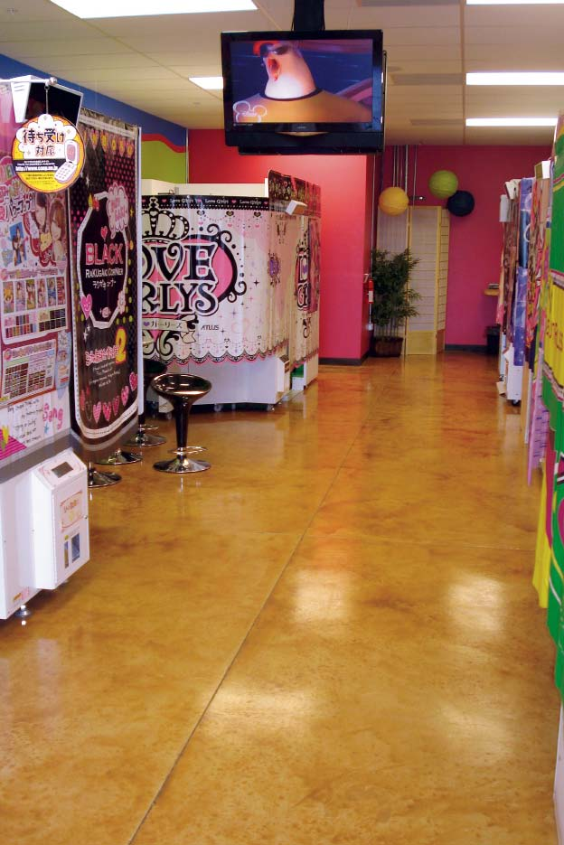 Salon floor stained concrete handles daily sweeping and cleaning.