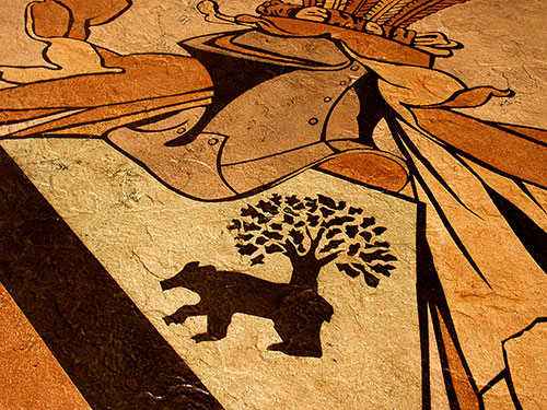 Bear and tree image stained into a concrete floor.
