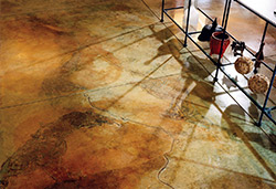 Shadows cast a neat light on the acid stained floor giving it dimension.