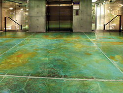 Blue and yellow acid stains were used to create a map like floor.
