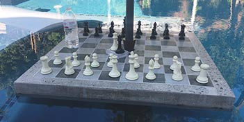 Concrete countertop with a chess board inlayed