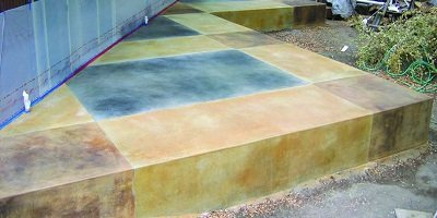 Acid stained concrete outdoor patio using multiple coats of concrete stain to get this look.