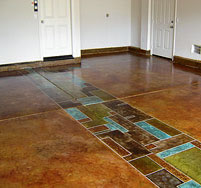 Acid stained and acrylic stained concrete floor in blues, greens and browns.