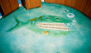 Acrylic acids were used to stained a fish with braces on this concrete floor.