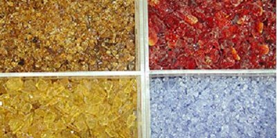 Colored glass used as aggregate in concrete countertop fabrication.
