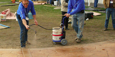Spraying concrete as a way to teach the attendees proper technique.